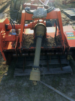 Specialized machine that is pulled behind a tractor to shred plant clippings